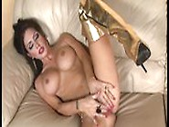 Big Titted Glamour Babe In Gold Lingerie Plays Solo
