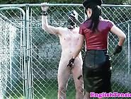 Latex Mistress Wanks Outdoors Caged Sub