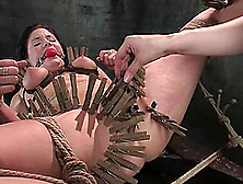 A Brunette Rides A Fucking Machine After Getting Pinched In Bdsm