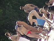 Uninhibited Beachgoers Let It All Hang Out On A Sunny Day A