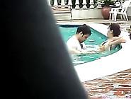 Pair Copulates In Public Pool With People Around 'em