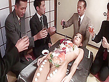 Business men eat sushi out a naked girl body