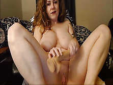 Sexy Redhead Cougar Squirting In The Cup