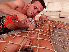 Bondage Action Where He Pins Her With A Net And Tortures Her