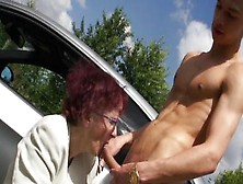 Lusty Redhead German Granny Sucking And Licking Young Cock Outdoor