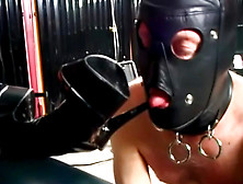 A Latex Slave Eats Stilettos
