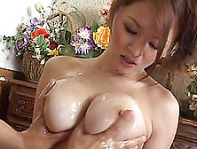 Oiled Japanese Cutie Yuki Touma Knows How To Give A Nice Titjob